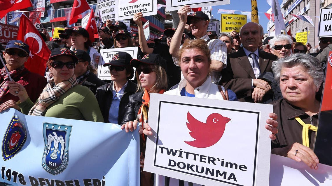 """Protesters hold placards reading """"do not touch my twitter """" and """"communication right is a basic human right"""" during a demonstration against the ban on Twitter during a demonstration against Turkish government in Ankara on March 22, 2014. (AFP)"""