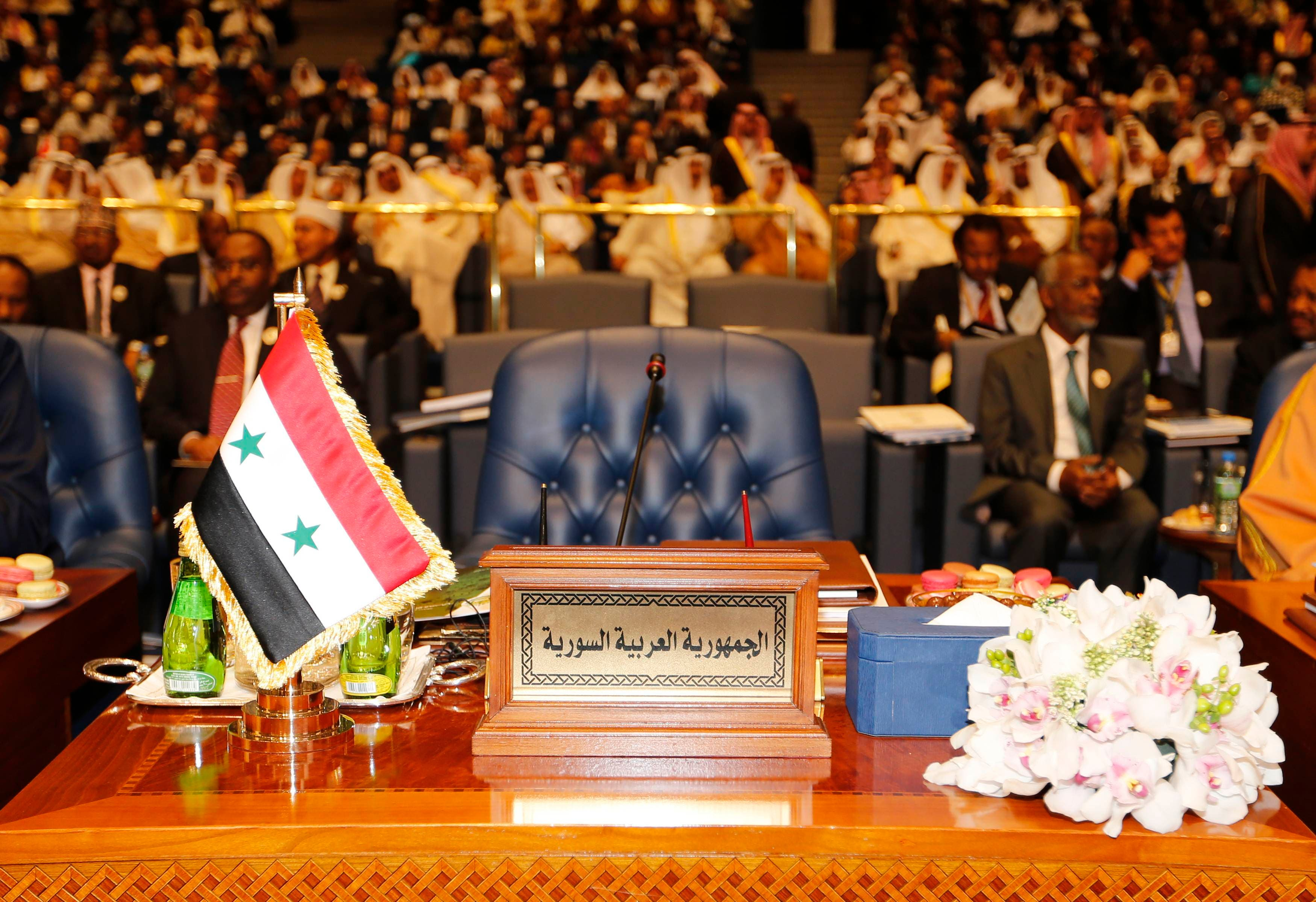 ARABS-SUMMIT/ The empty seat of the Syrian delegation is seen during the 25th Arab Summit in Kuwait City, March 25, 2014.