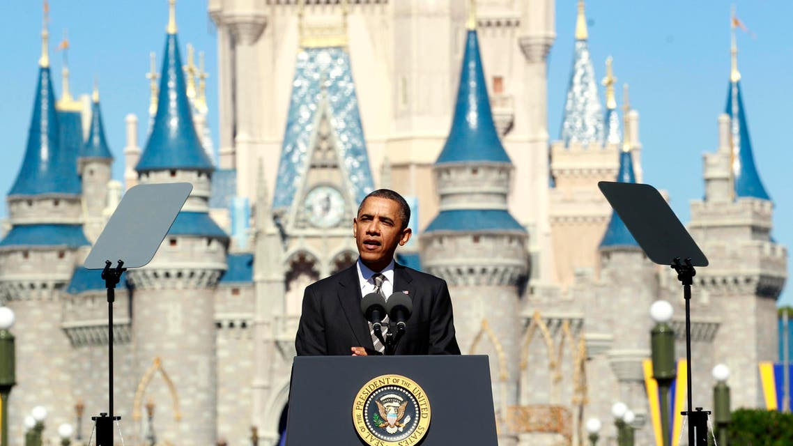 U.S. President Barack Obama unveils a strategy aimed at boosting tourism and travel in front of Cinderella's Castle at Disney World's Magic Kingdom in Orlando January 19, 2012. reuters