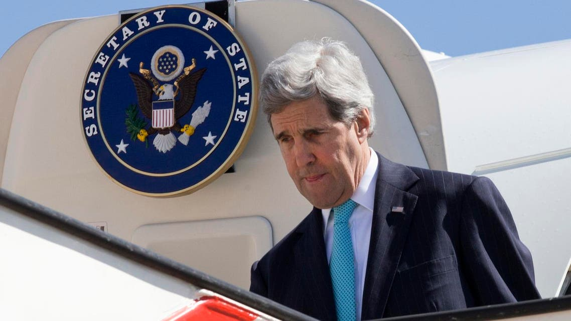 U.S. Secretary of State John Kerry leaves his plane as he arrives in Amman March 26, 2014. (AFP)
