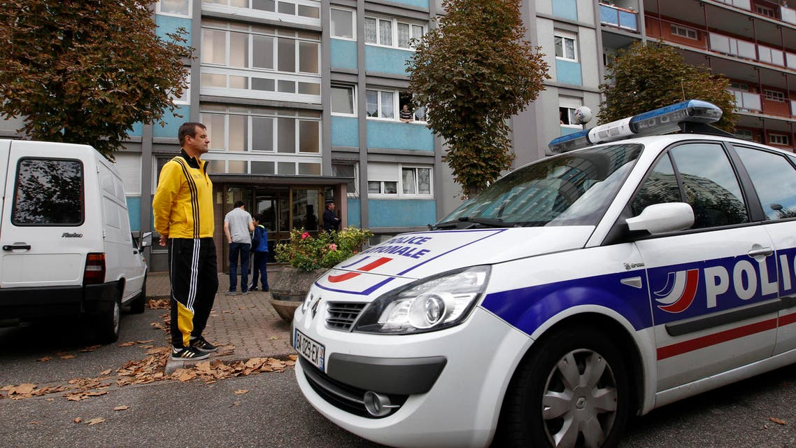 A police car is seen parked in front of a building in the Esplanade suburb of Strasbourg October 6, 2012.