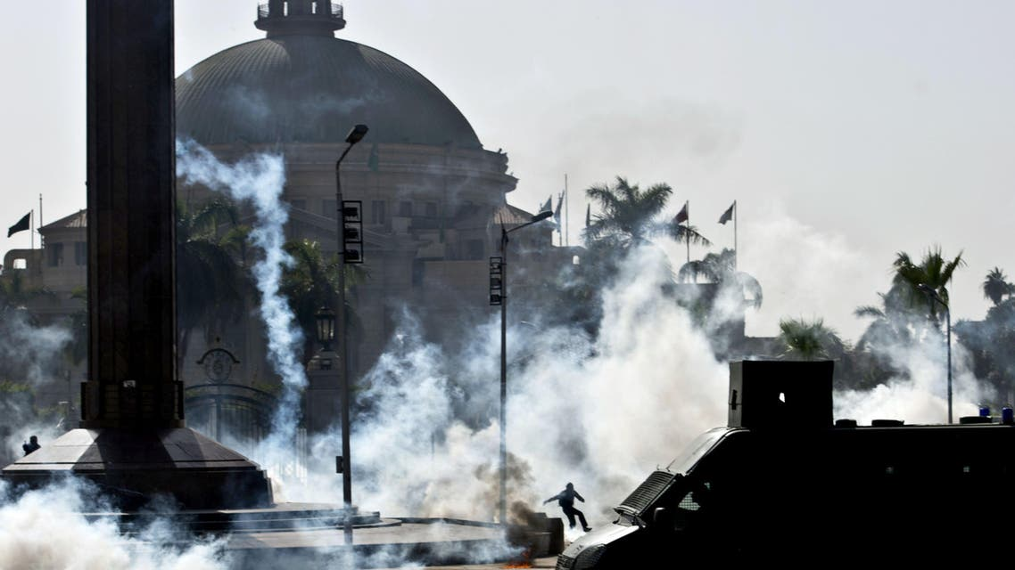 Egyptian students who support the Muslim Brotherhood and ousted Islamist President Mohammad Mursi run from tear gas fired by riot police during clashes following a demonstration outside Cairo University on March 26, 2014.  (Reuters)