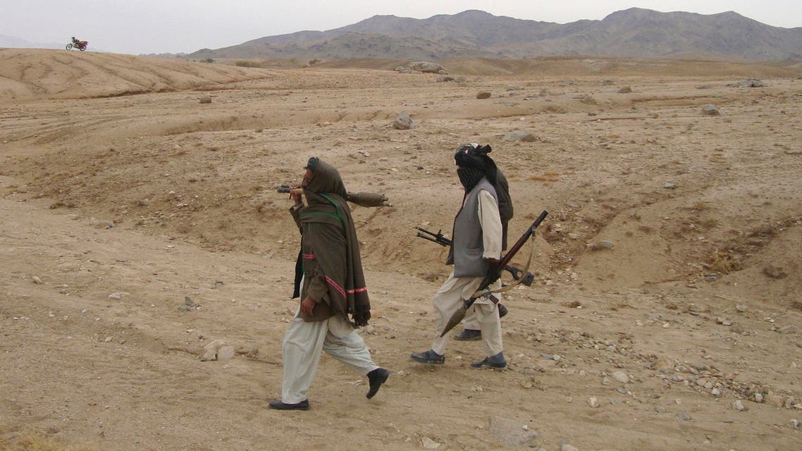 Taliban fighters walk with their weapons at an undisclosed location in Afghanistan Oct. 30, 2009. (File: Reuters)