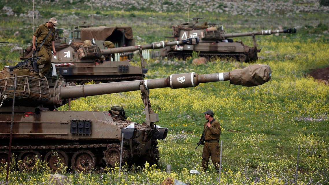 An Israeli soldier stands beside a mobile artillery unit near the town of Katzrin in the Golan Heights March 19, 2014. reuters