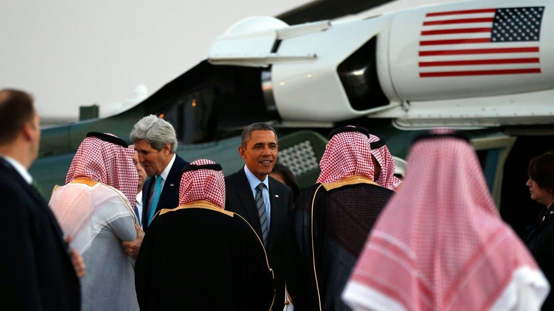 U.S. Secretary of State John Kerry (L) and U.S. President Barack Obama are greeted upon their arrival on Marine One for a meeting with Saudi King Abdullah at Rawdat al-Khraim (Desert Camp) near Riyadh in Saudi Arabia, March 28, 2014 reuters