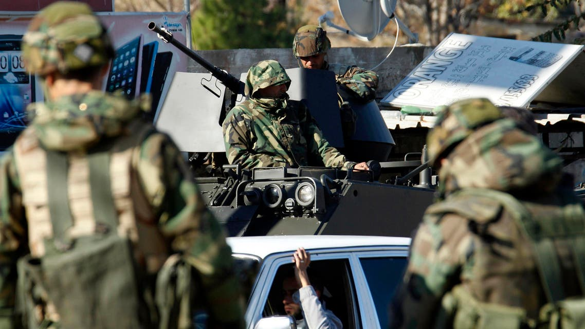 Lebanese army soldiers are seen on their military vehicles as they are deployed on the streets of Sidon, southern Lebanon Dec.16, 2013. (Reuters)