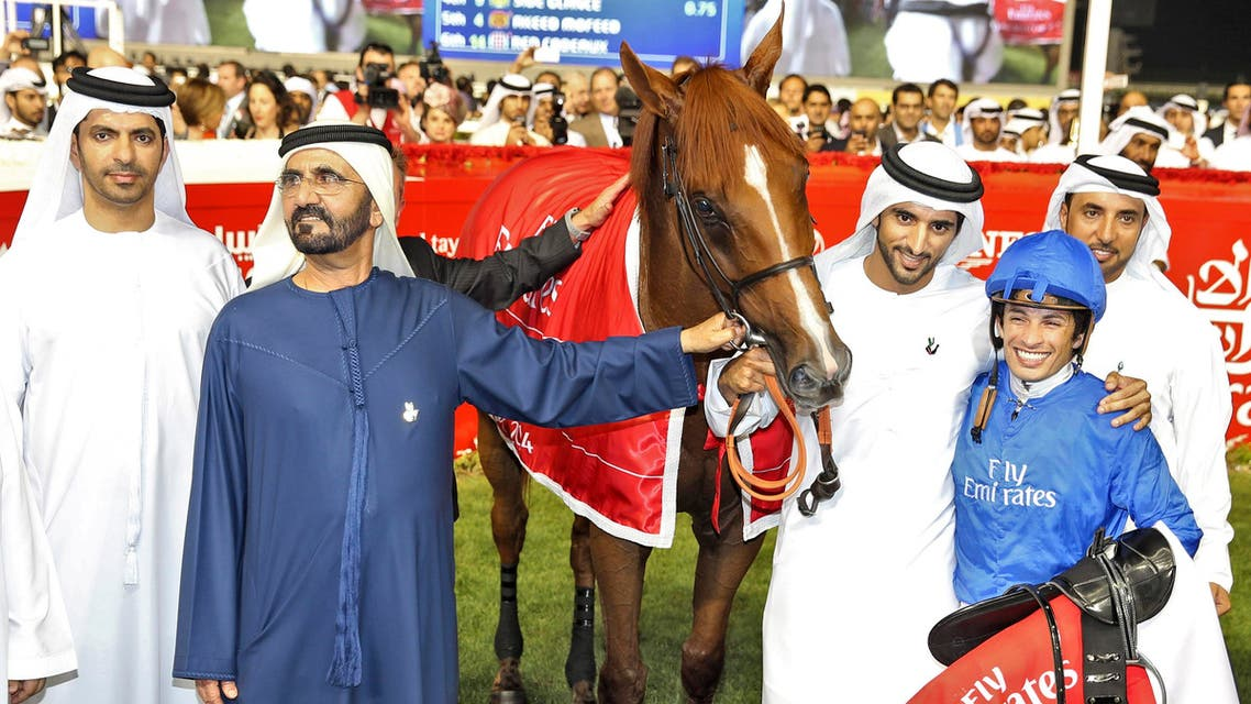 United Arab Emirates' Prime Minister and Ruler of Dubai Mohammed bin Rashid al-Maktoum poses with his horse African Story after winning the Dubai World Cup at Meydan Racecourse in Dubai March 29, 2014. (Reuters)