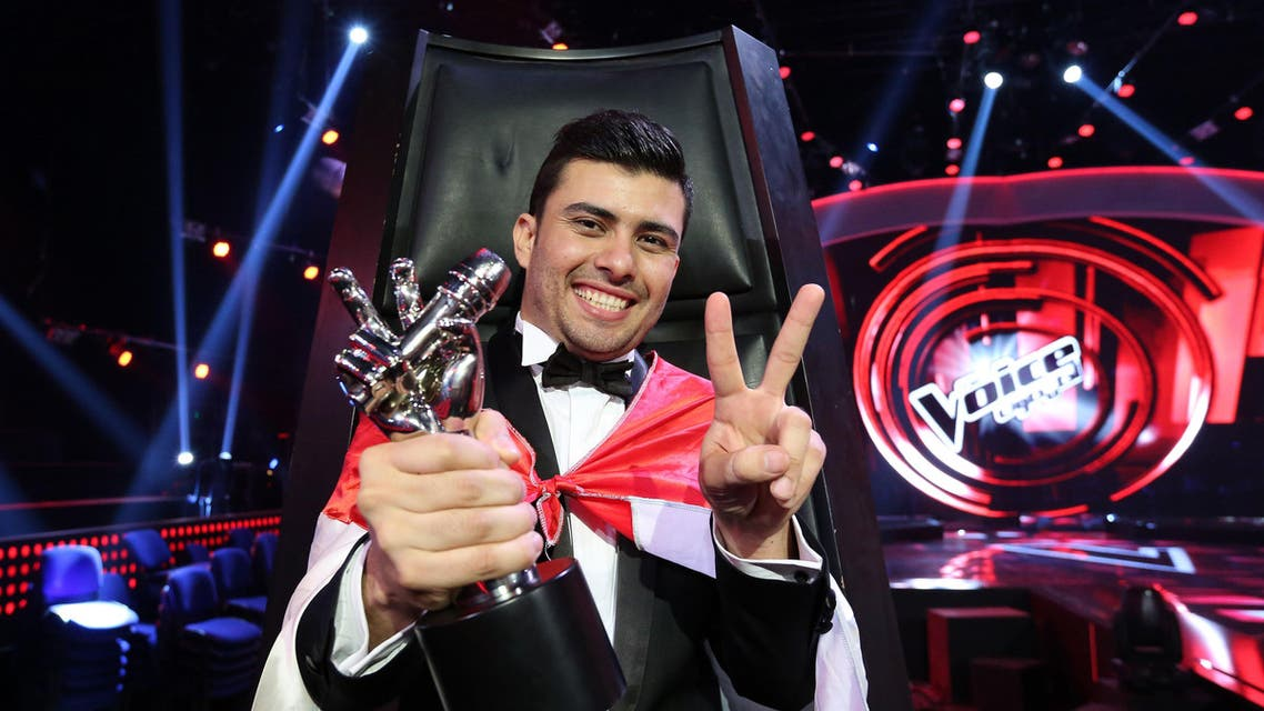 Sattar Saad from Iraq poses with his trophy flashing the sign of victory after he was named the winner afp