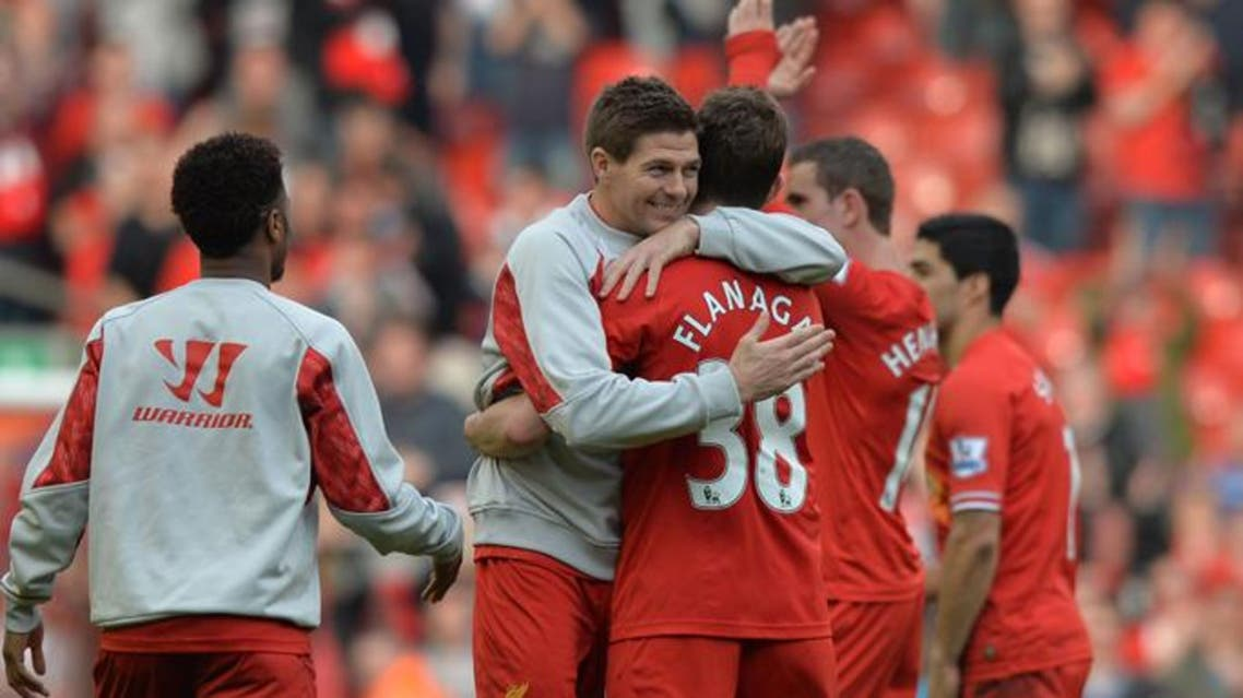 Liverpool's English midfielder Steven Gerrard (L) embraces Liverpool's English defender Jon Flanagan (R) after Liverpool's victory in the English Premier League football match between Liverpool and Tottenham Hotspur at Anfield in Liverpool, northwest England on March 30, 2014. (Reuters)