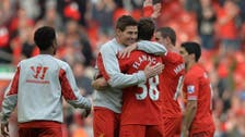 Liverpool crush Tottenham to go top