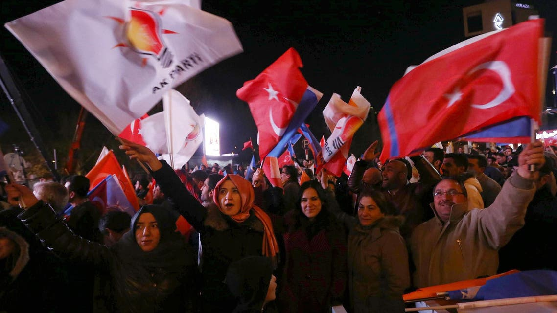 Supporters of Turkey's ruling AK party (AKP) cheer as they follow the election's results in front of the party's headquarters in Ankara, on March 30, 2014. (AFP)