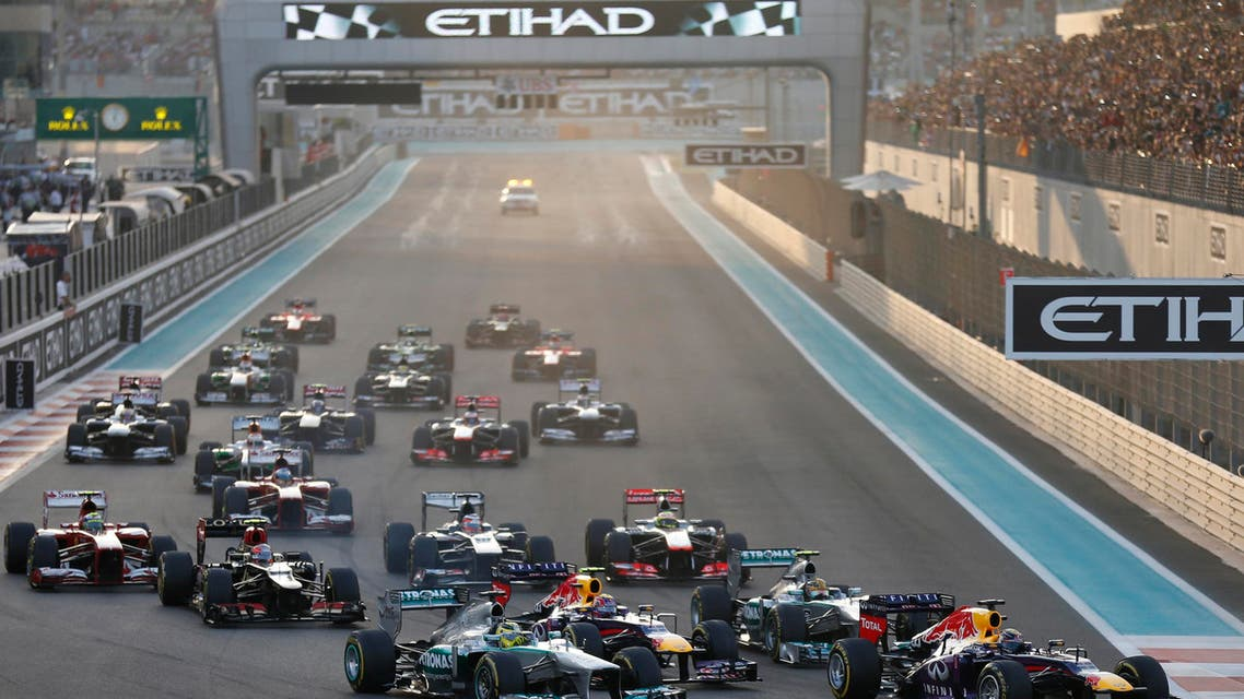 Red Bull Formula One driver Sebastian Vettel of Germany (R) leads the pack during the Abu Dhabi F1 Grand Prix at the Yas Marina circuit on Yas Island, November 3, 2013. (File: Reuters)