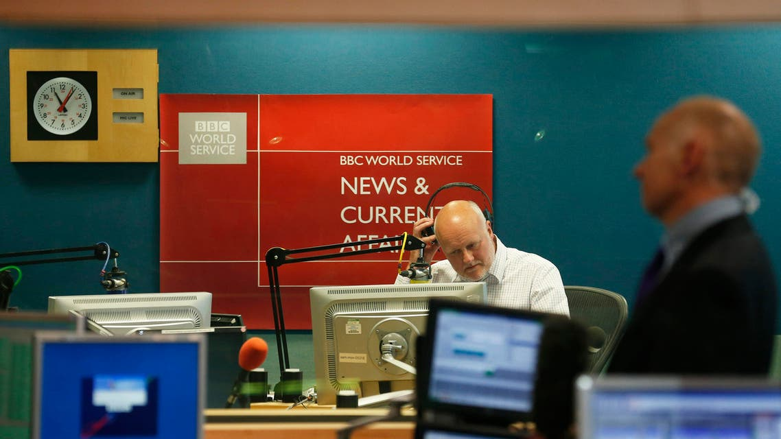 BBC newsreader Iain Purdon takes off his headphones after delivering the final BBC World Service news bulletin from BBC Bush House in central London reuters