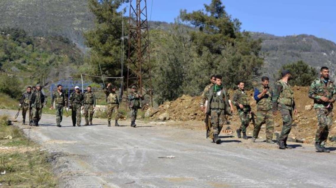 Pro-regime soldiers are seen marching on a road in the village of Kasab, in the northwestern province of Latakia, on March 27, 2014. (AFP)
