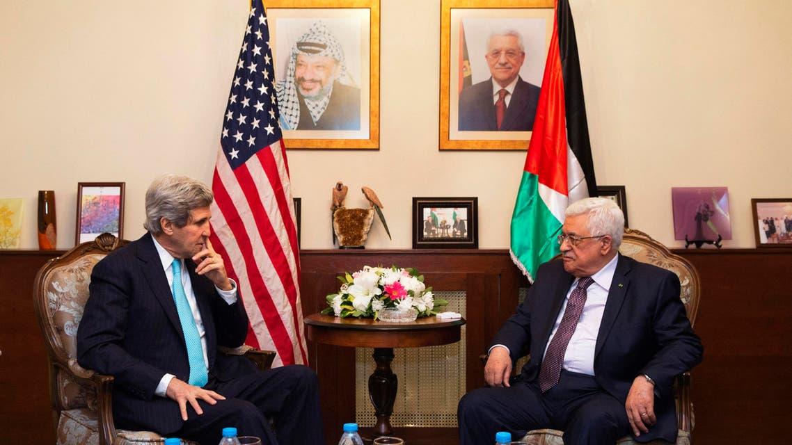 U.S. Secretary of State John Kerry (L), meets with Palestinian President Mahmoud Abbas, at the Palestinian Ambassador?s Residence in Amman, Jordan March 26, 2014. (Reuters)