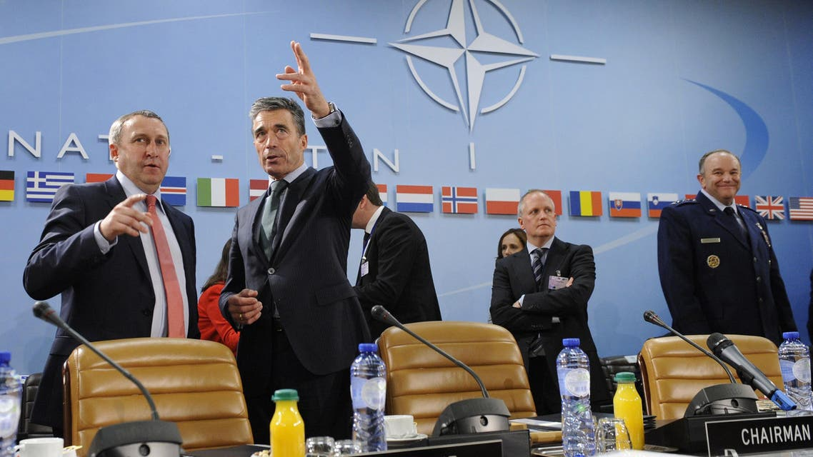 Ukraine Foreign Affairs minister Andrii Deshchytsia (L) speaks with NATO Secretary General Anders Fogh Rasmussen (2ndL) during the Nato-Ukraine Foreign Affairs meeting at the NATO headquarters in Brussels on April, 01 2014. (AFP)
