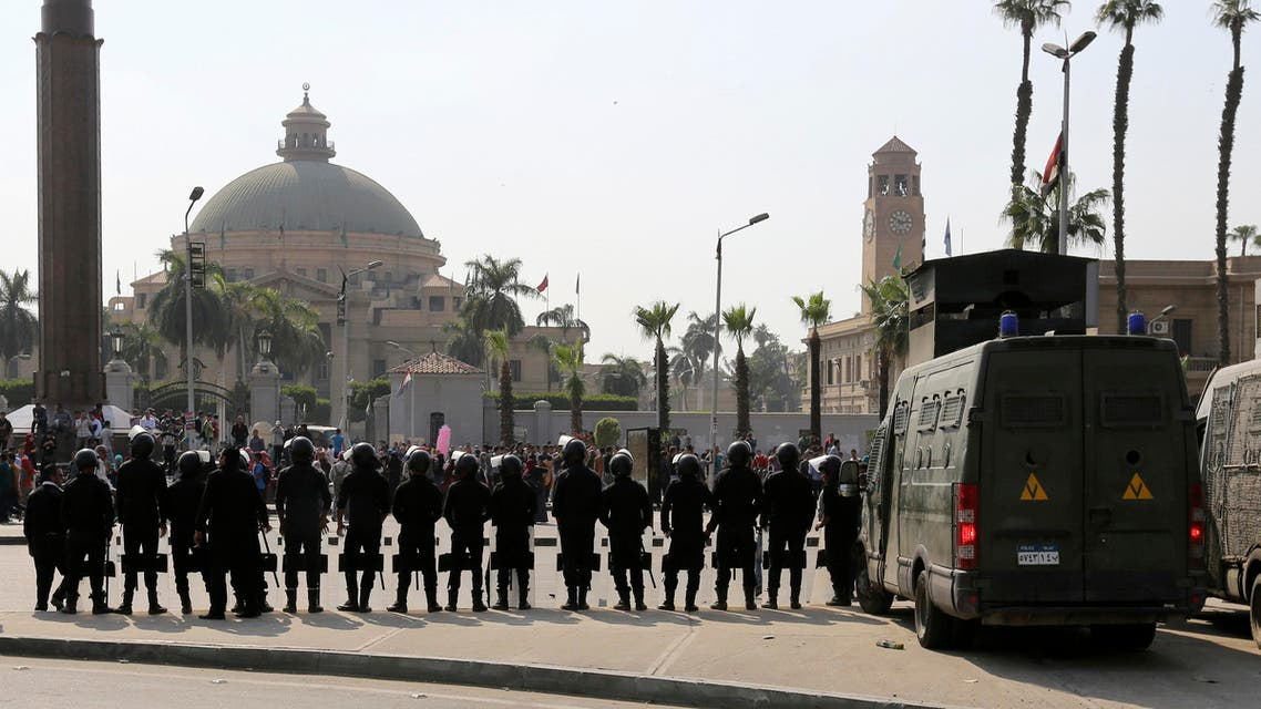 Riot police officers take positions in front of Cairo University. (File photo: Reuters)