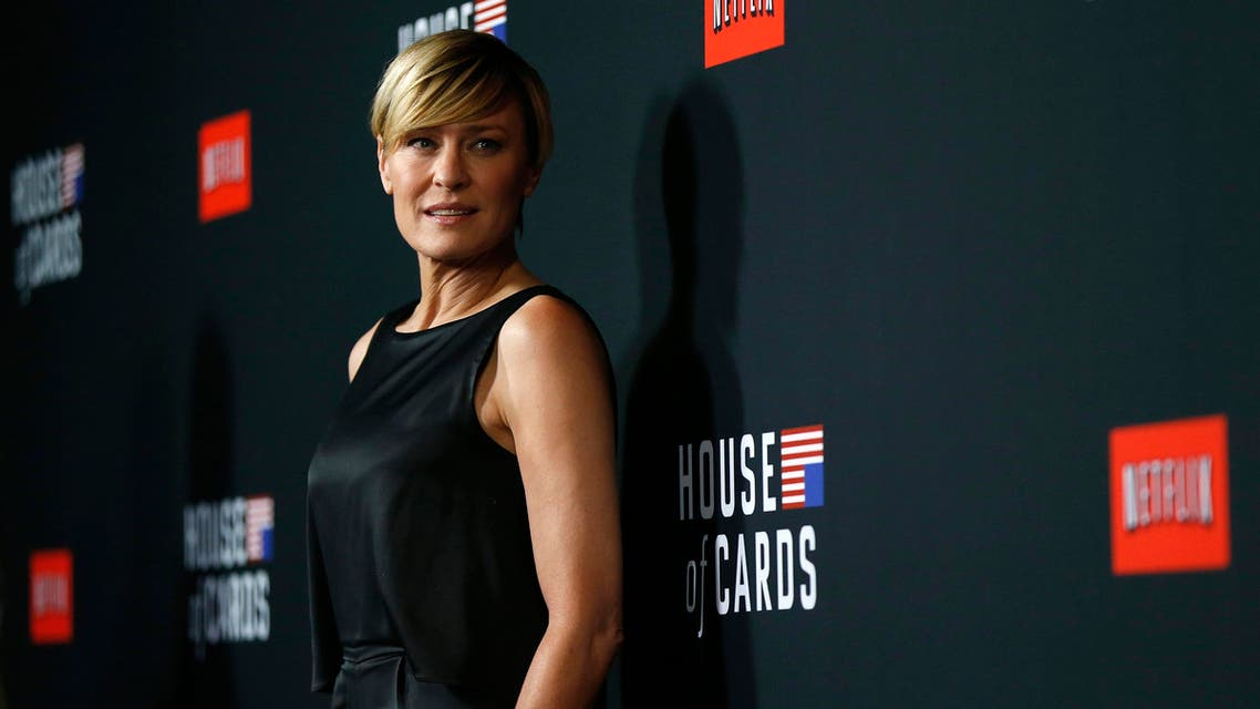 """Cast member Robin Wright poses at the premiere for the second season of the television series """"House of Cards"""" at the Directors Guild of America in Los Angeles, California Feb. 13, 2014. (Reuters)"""