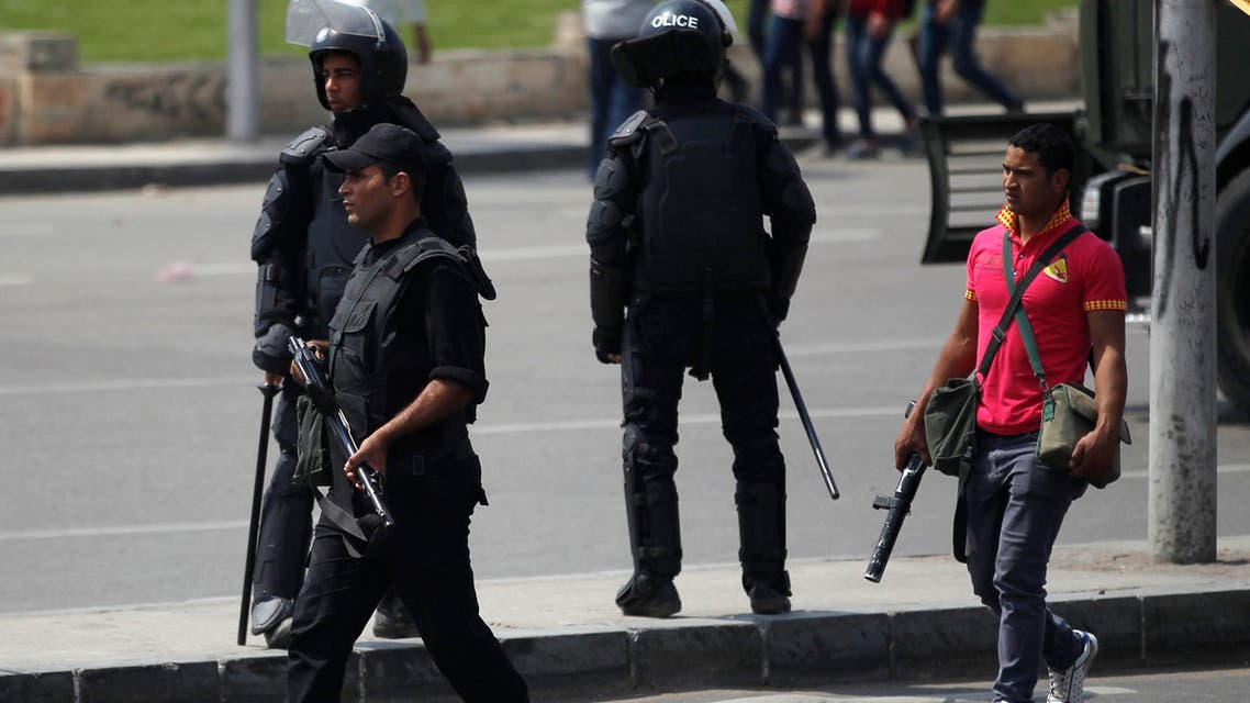 Riot police take their positions near the site of a series of explosions in front of Cairo University April 2, 2014. (Reuters)