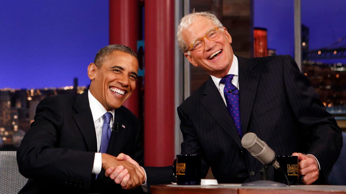 """Seated with talk show host David Letterman, U.S. President Barack Obama makes an appearance on the """"Late Show with David Letterman"""" reuters"""