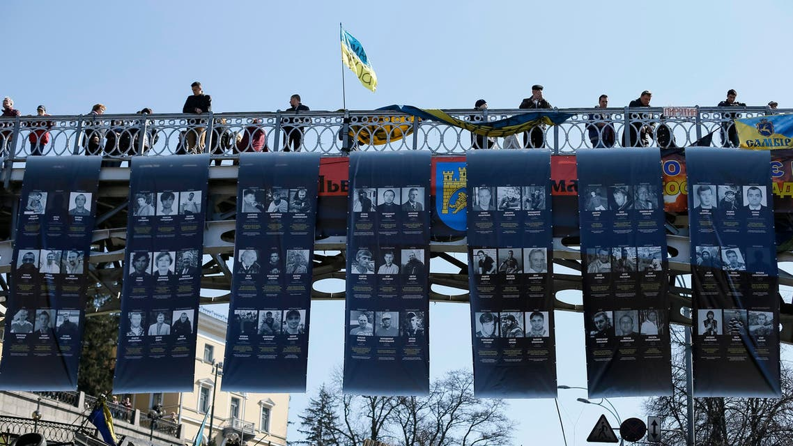 Posters with images of people killed in recent clashes are seen at the site of the clashes in Kiev March 30, 2014. (Reuters)