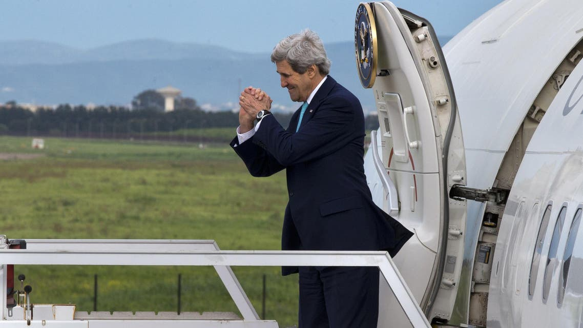 US Secretary of State John Kerry gestures while leaving Algeria en route to Rabat, Morocco on April 3, 2014. (AFP)