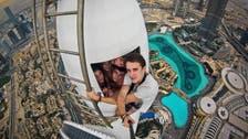 Video: extreme Russian climbers scale Dubai skyscrapers