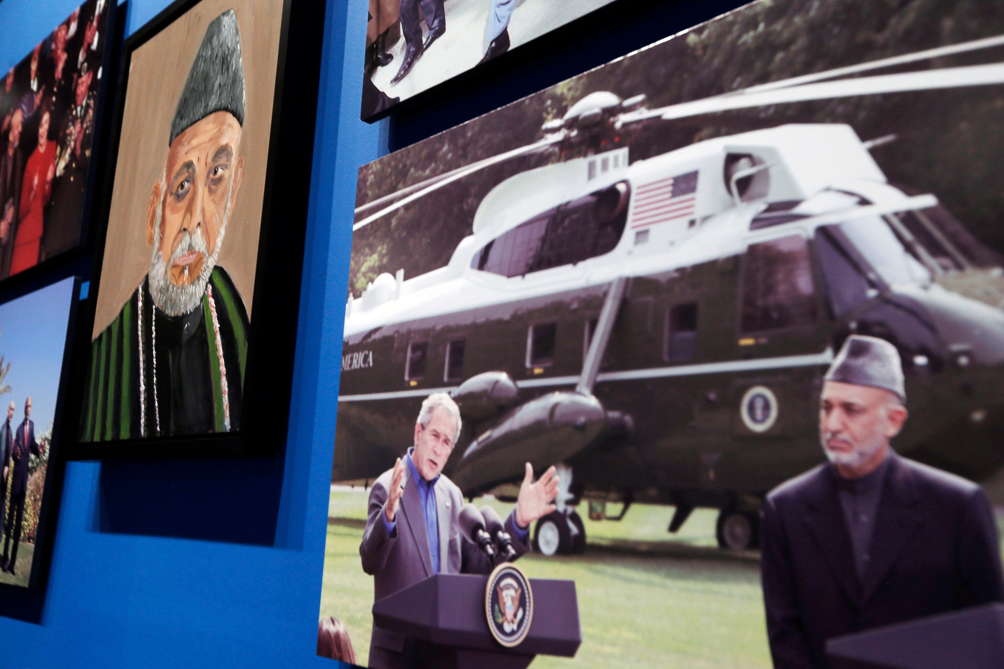 A portrait of Afghan President Hamid Karzai, painted by former U.S. President George W. Bush, is displayed at an exhibit at the Bush Presidential Library and Museum in Dallas, Texas April 4, 2014. (Reuters)