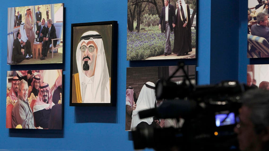 """A portrait of Saudi Arabia's King Abdullah, painted by former U.S. President George W. Bush, hangs on display during """"The Art of Leadership: A President's Personal Diplomacy"""" exhibit. Reuters"""