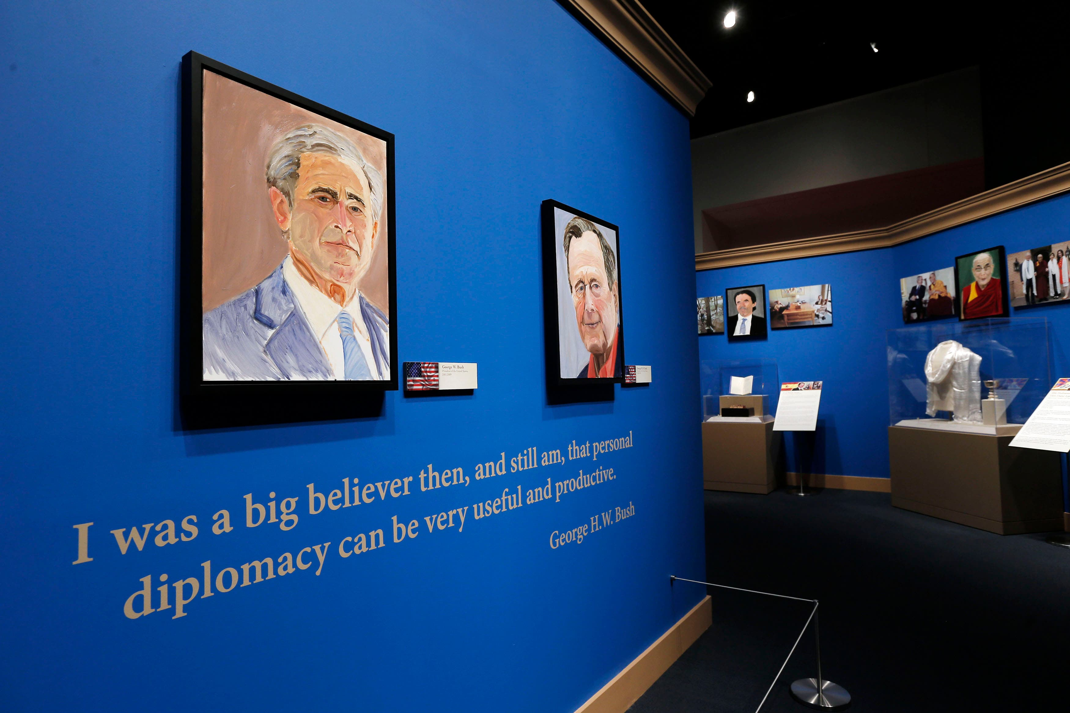 A self-portrait of former U.S. President George W. Bush and his father, former U.S. President George H.W. Bush,  at an exhibit at the Bush Presidential Library and Museum in Dallas, Texas April 4, 2014. (Reuters)