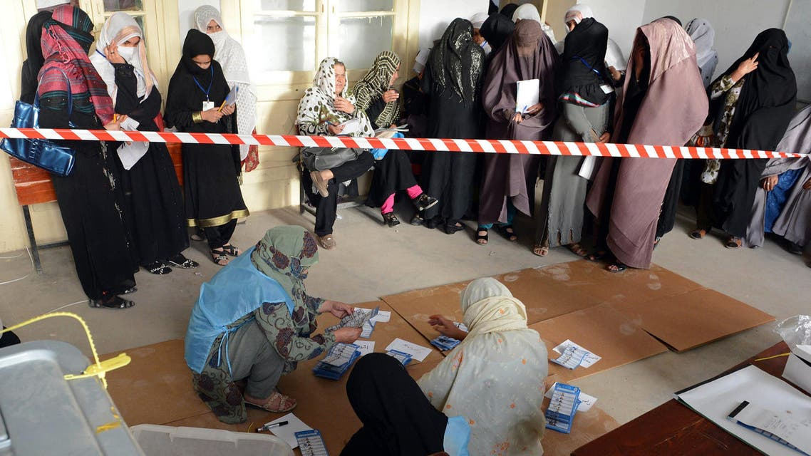 Afghan election officials count ballot papers at the end of polling in Kandahar on April 5, 2014. (AFP)