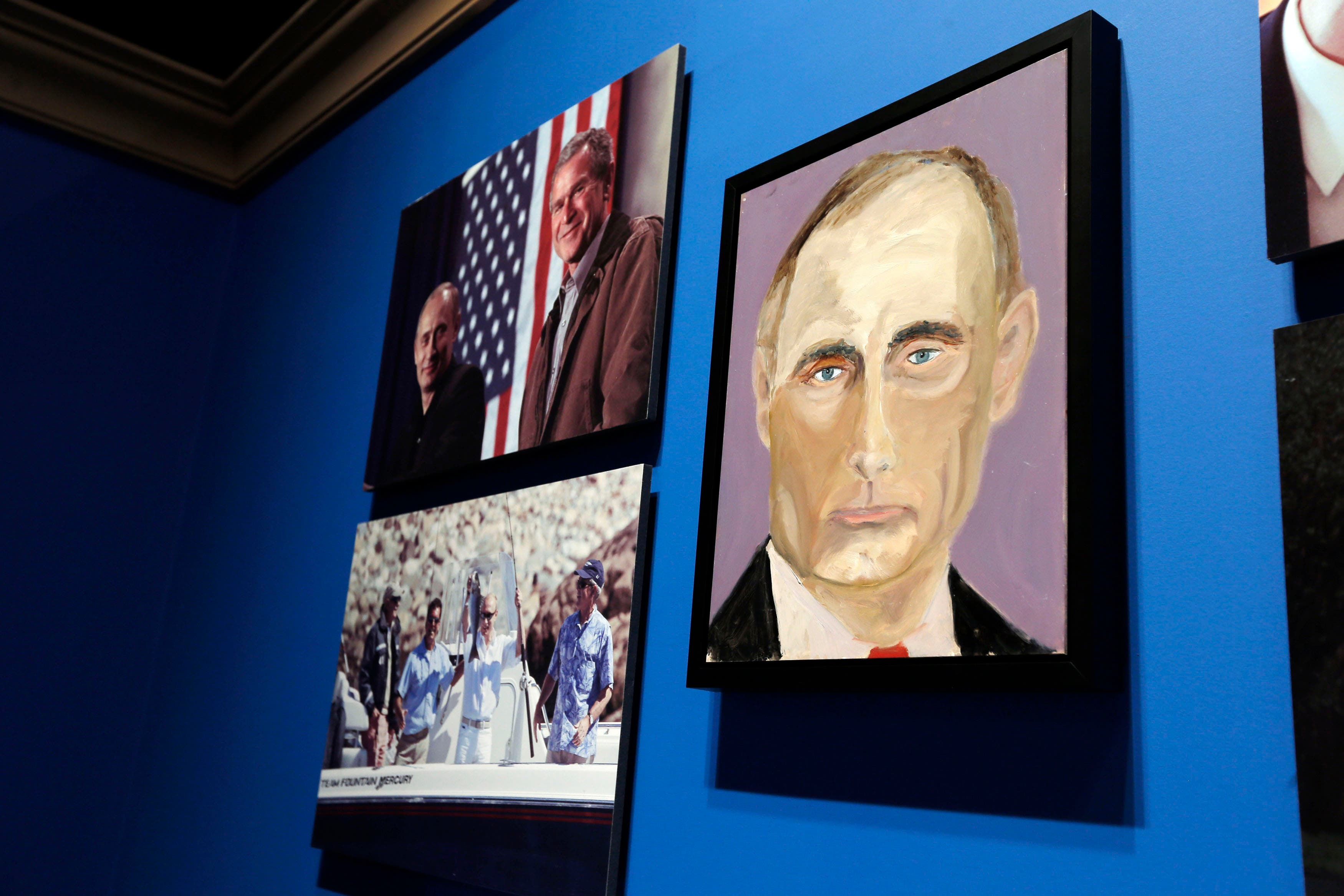 A portrait of Russian President Vladimir Putin, painted by former U.S. President George W. Bush, is displayed at an exhibit at the Bush Presidential Library and Museum in Dallas, Texas April 4, 2014. (Reuters)