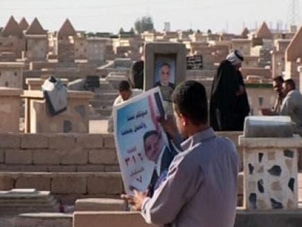 دعاية انتخابية عند القبور في الانتخابات العراقية