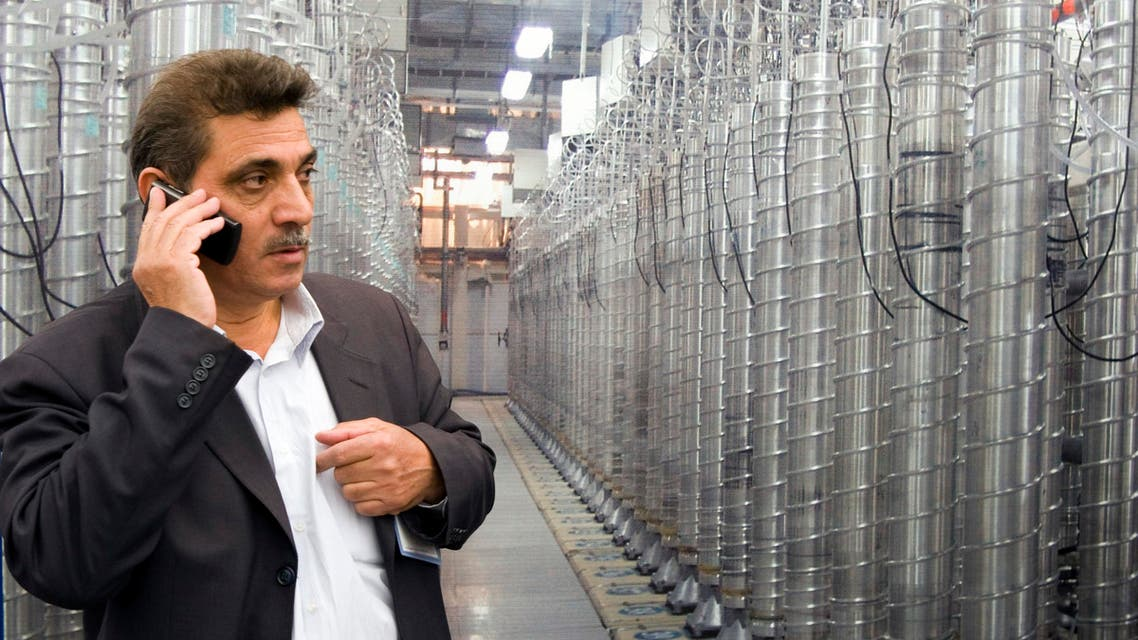 An official from Iran's Atomic Energy Organization speaks on his mobile phone in front of uranium enriching centrifuges at an exhibition of Iran's nuclear achievements at Shahid Beheshti University in Tehran April 20, 2009. (File: Reuters)