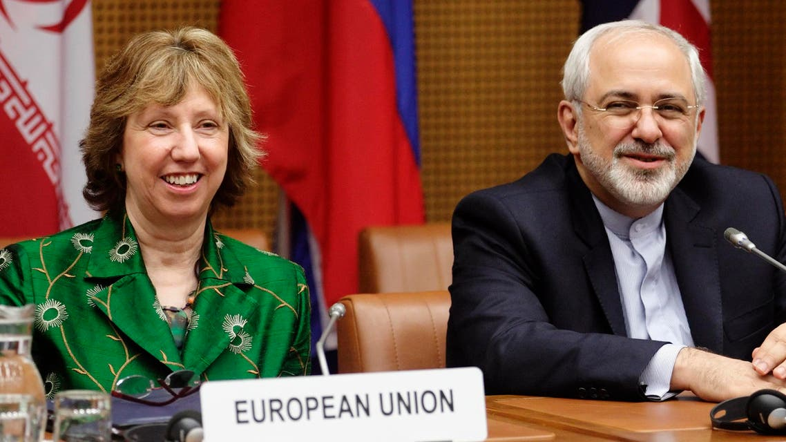 European Union foreign policy chief Catherine Ashton (L) and Iranian Foreign Minister Mohammad Javad Zarif smile at the start of talks in Vienna April 8, 2014. Reuters