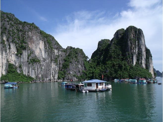 Number 8: Ships pass in front of rock formations in Halong Bay, Hanoi - ranked the eighth best world destination