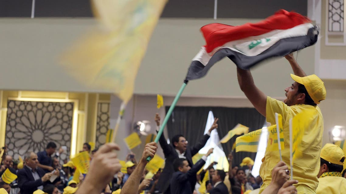 Iraqi supporters cheer as Shiite Muslim leader Ammar al-Hakim (unseen), head of the Islamic Supreme Council of Iraq (ISCI). (AFP)