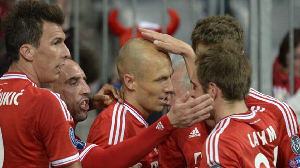 Bayern Munich's Dutch midfielder Arjen Robben (C) celebrates with teammates after scoring during the UEFA Champions League quarter-final second leg football match Bayern Munich vs Manchester United in Munich, southern Germany, on April 9, 2014.