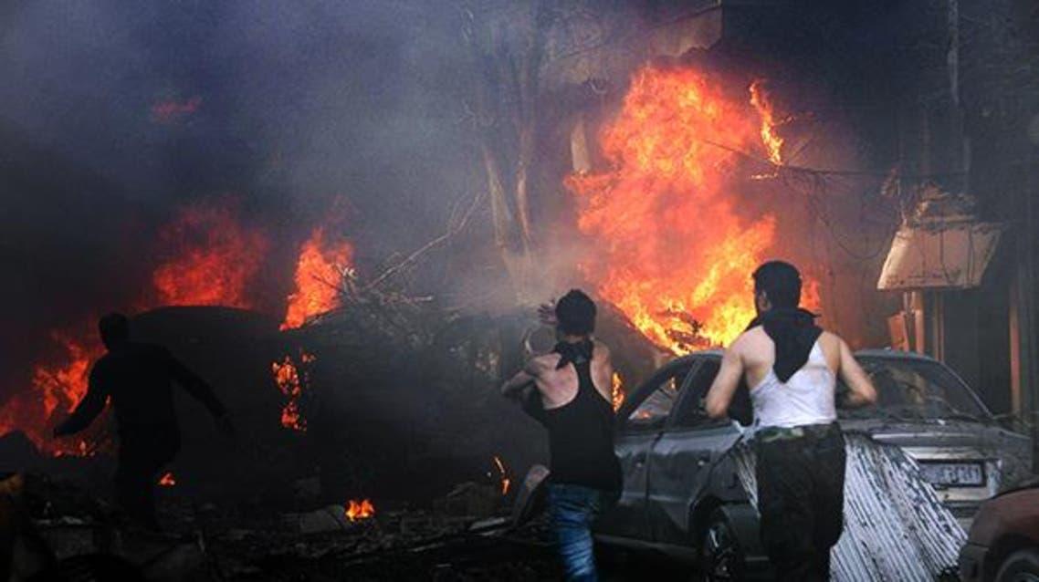 25 قتيلاً في تفجير سيارتين مفخختين في حمص