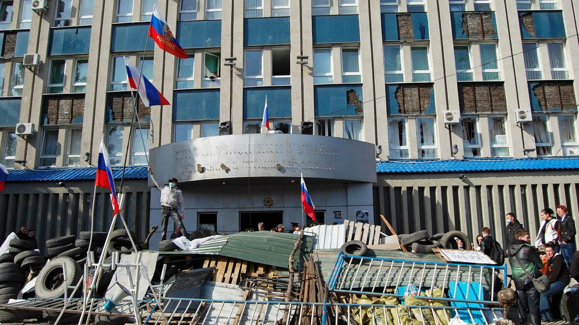 Pro-Russian protesters gather at a barricade outside the offices of the SBU state security service in Luhansk, in eastern Ukraine April 7, 2014. (Reuters)