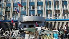 Dozens leave building seized in Ukraine