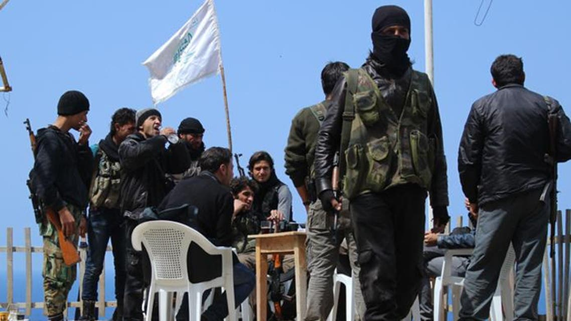 Rebel fighters from the Ansar al-Sham brigade hold a position on a ridge overlooking the Mediterranean sea reportedly in the village of Kasab, in the northwestern Syrian province of Latakia. (Reuters)