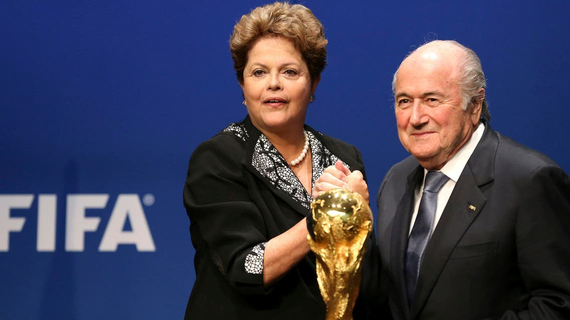 Brazil's President Dilma Rousseff (L) poses with FIFA President Sepp Blatter after delivering a statement at the FIFA headquarters in Zurich January 23, 2014.(AFP)