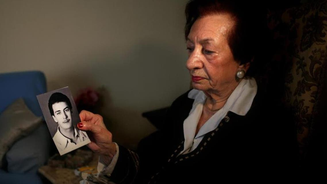 Lebanese Mary Mansourati, 82, whose son Dani went missing in Syria in 1992 at the age of 30, show his portrait during an interview with the Associated Press at her house, in Beirut, Lebanon. (AP)