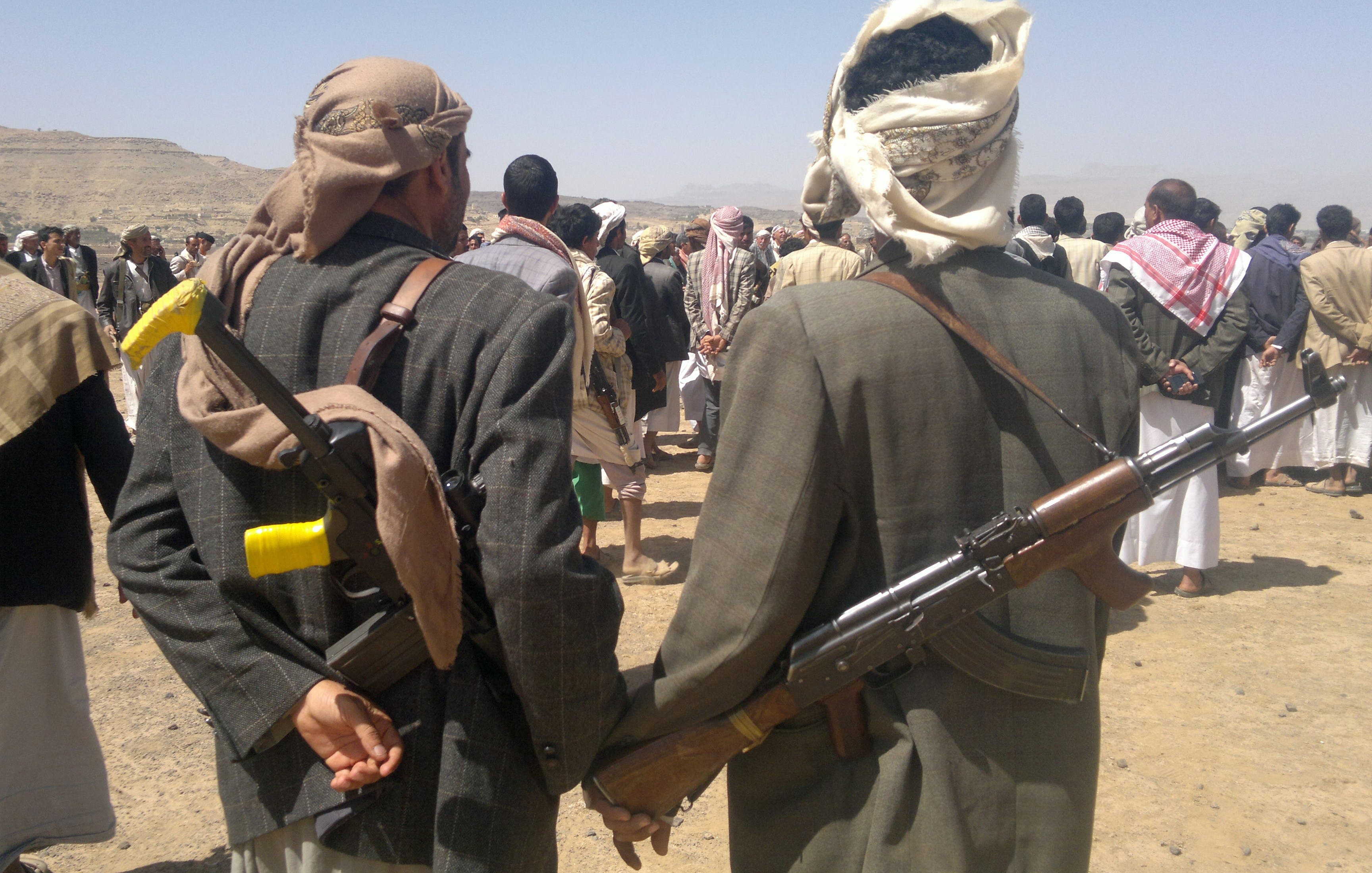 Yemeni Houthi tribesmen gather north of the capital Sanaa on April 10, 2014 as they rally against the death of five people killed in fighting between tribesmen and Yemeni soldiers. (AFP)