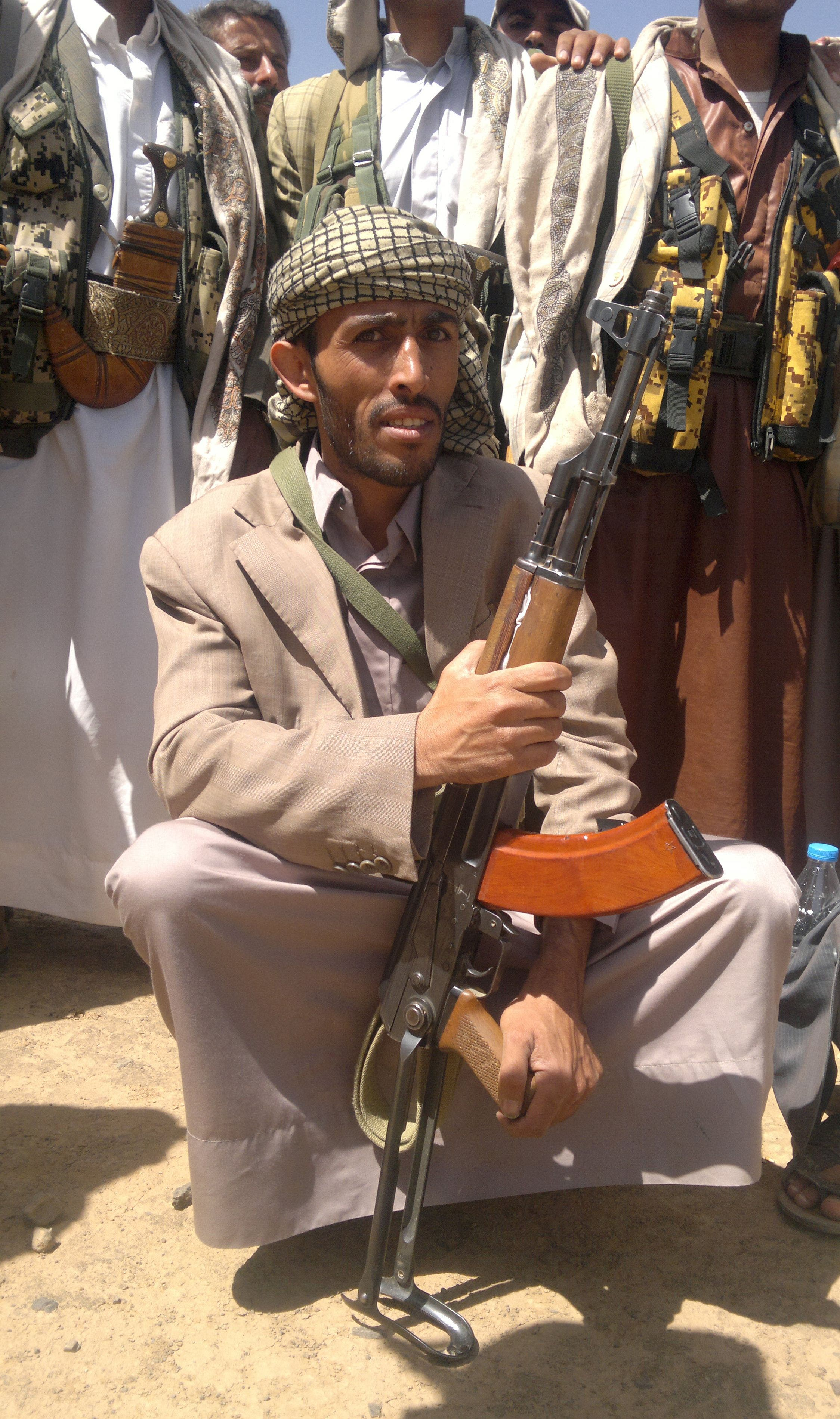 A Yemeni Houthi tribesman poses for a photo in Amran, fifty kilometres north of the capital Sanaa on April 10, 2014. (AFP)