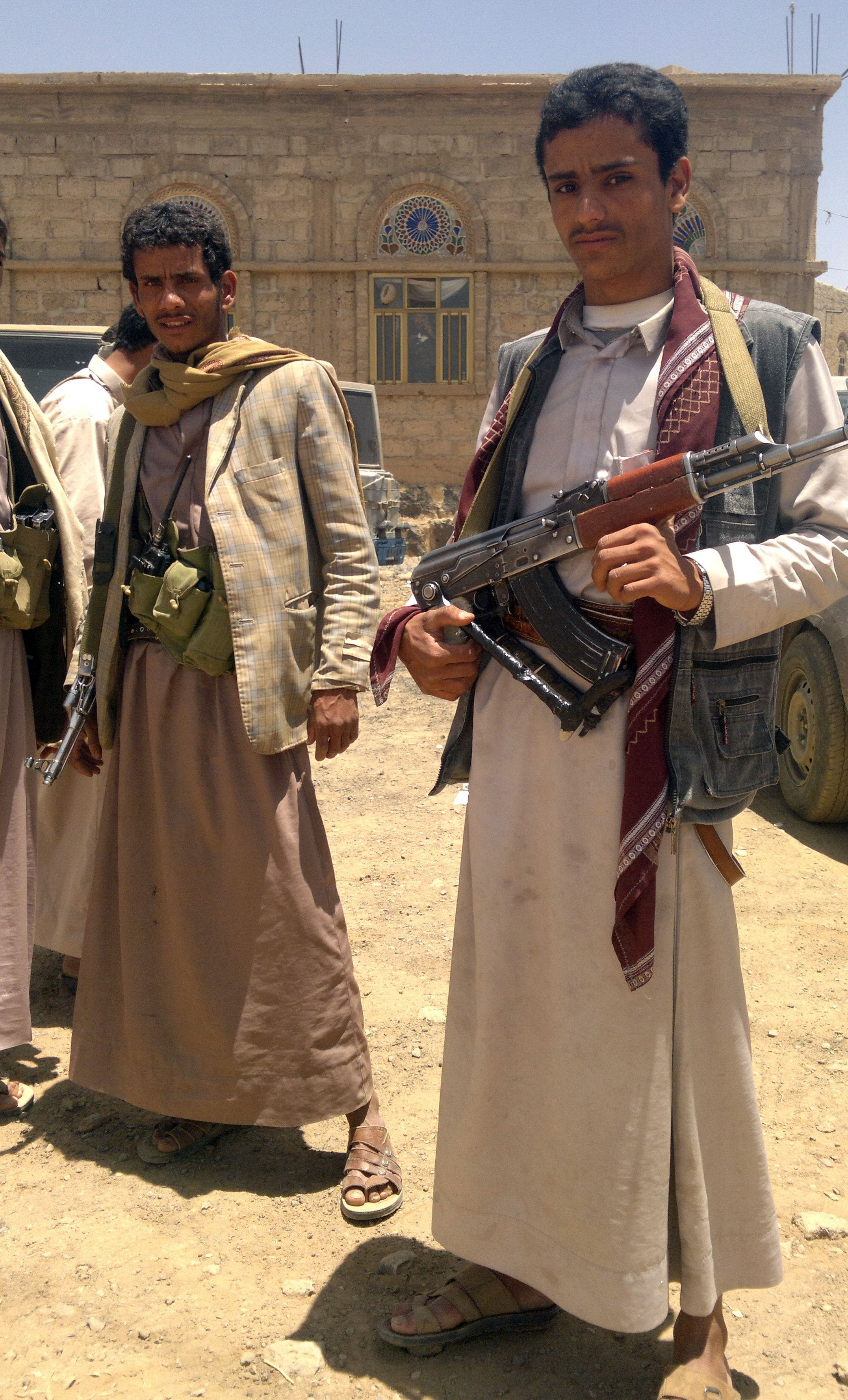 Yemeni Houthi tribesmen pose for a photo north of the capital Sanaa on April 10, 2014 as they rally against the death of five people killed in fighting between tribesmen and the Yemeni army. (AFP)