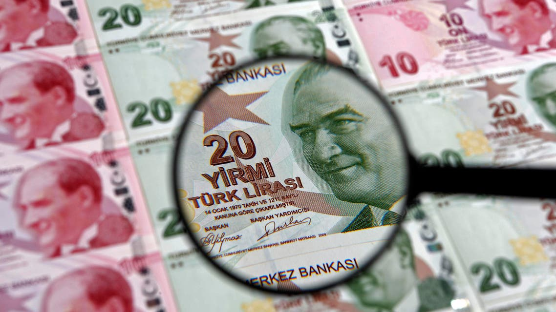 A 20 lira banknote is seen through a magnifying lens in this illustration picture taken in Istanbul, Jan. 28, 2014. (Reuters)
