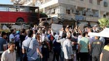 """""""باص"""" أحمر يقسم حلب إلى نصفين"""