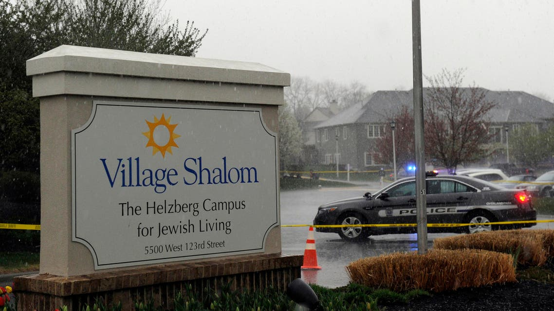 A police car blocks the scene of a shooting at Village Shalom, an assisted living center, as rain falls in Overland Park, Kansas April 13, 2014. (Reuters)